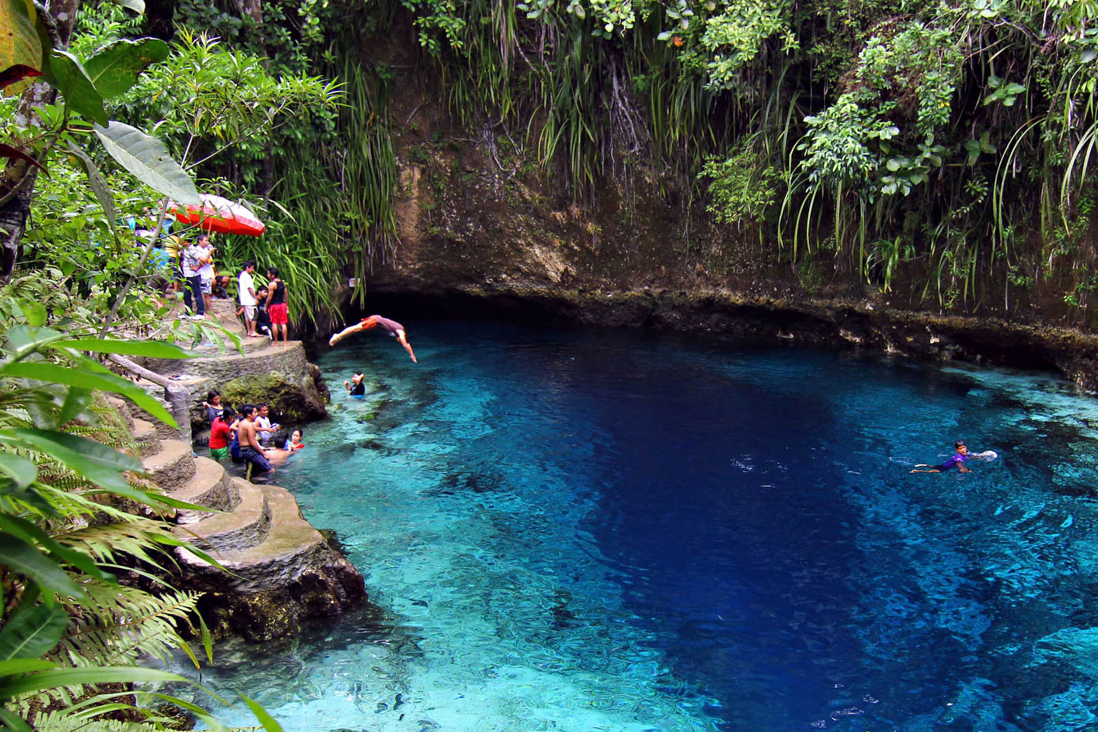 TRULY ENCHANTED. Local tourists enjoy swimming in the blue waters of the Enchanted River in Hinatuan town in Surigao del Sur on June 22, 2012. MindaNews photo by Erwin Mascarinas